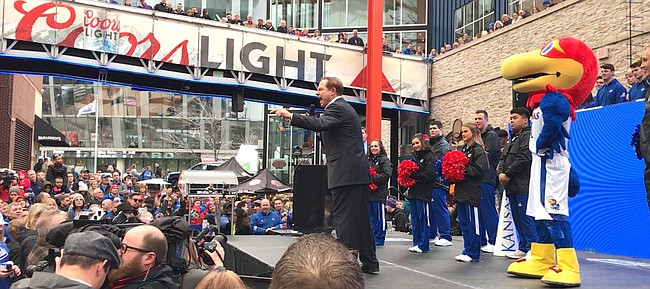 Kansas football coach Les Miles screams into his microphone while firing up the KU-friendly crowd at a pep rally for the Big 12 tournament on March 14, 2019, in Kansas City, Mo.