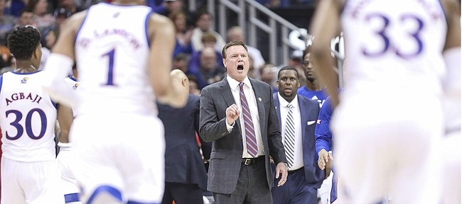 Kansas head coach Bill Self pulls his team in during a timeout in the first half, Thursday, March 14, 2019 at Sprint Center in Kansas City, Mo.