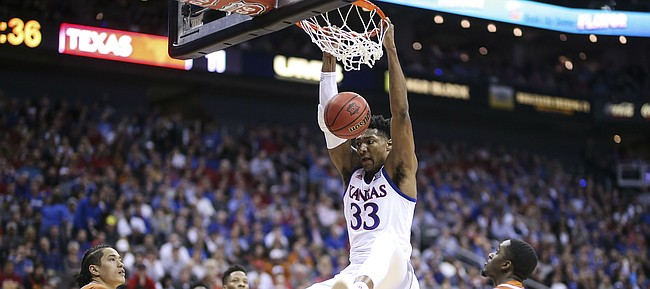 Kansas forward David McCormack (33) puts down a dunk against Texas during the first half, Thursday, March 14, 2019 at Sprint Center in Kansas City, Mo.