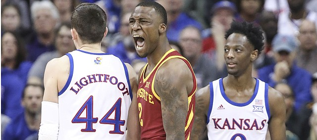 Iowa State forward Cameron Lard (2) roars after a bucket and a foul by Kansas guard Marcus Garrett (0) during the first half, Saturday, March 16, 2019 at Sprint Center in Kansas City, Mo.