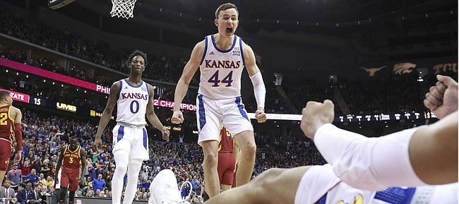 Kansas forward Mitch Lightfoot (44) celebrates after a bucket and an Iowa State foul on Kansas guard Quentin Grimes (5) during the first half, Saturday, March 16, 2019 at Sprint Center in Kansas City, Mo.