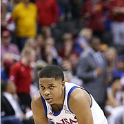 Kansas guard Charlie Moore (2) waits out a couple of free throws as Iowa State guard Lindell Wigginton (5) and Iowa State guard Tyrese Haliburton (22) celebrate with less than a minute to play in the game, Saturday, March 16, 2019 at Sprint Center in Kansas City, Mo.