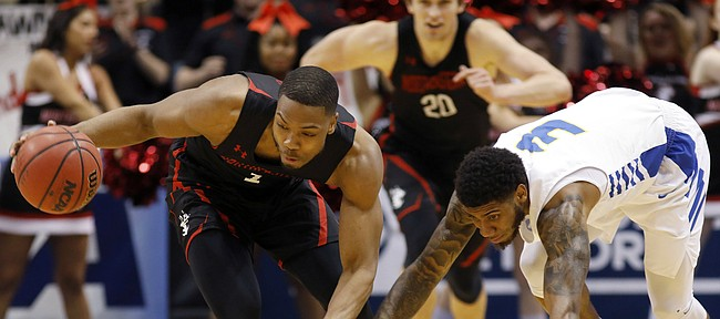 Northeastern's Shawn Occeus, left, drives down the court against Hofstra's Justin Wright-Foreman in the first half of an NCAA college basketball game at the Colonial Athletic Association men's basketball championship, Tuesday, March 12, 2019, in North Charleston, S.C. (AP Photo/Mic Smith)