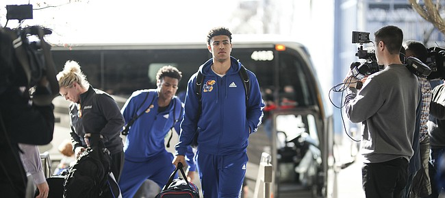 Kansas guards Quentin Grimes and Ochai Agbaji head into the team hotel upon their arrival in Salt Lake City, Utah. The Jayhawks will practice on Wednesday in preparation for their opening round game against the Northeastern Huskies.