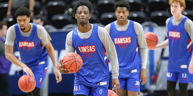 Kansas guard Marcus Garrett (0) and his teammates take off up the court as they get warmed up for a shoot around on Wednesday, March 20, 2019 at Vivint Smart Home Arena in Salt Lake City, Utah. Teams practiced and gave interviews to media members before Thursday's opening round games.