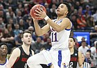 Kansas guard Devon Dotson (11) floats to the bucket past Northeastern guard Myles Franklin (13) during the second half, Thursday, March 21, 2019 at Vivint Smart Homes Arena in Salt Lake City, Utah.