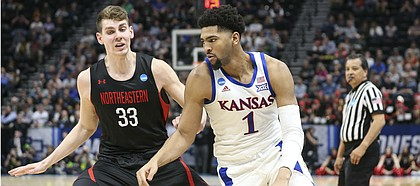Kansas forward Dedric Lawson (1) looks to drive against Northeastern forward Tomas Murphy (33) during the second half, Thursday, March 21, 2019 at Vivint Smart Homes Arena in Salt Lake City, Utah.