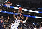 Kansas forward Dedric Lawson (1) has his shot rejected by Auburn forward Chuma Okeke (5) during the first half on Saturday, March 23, 2019 at Vivint Smart Homes Arena in Salt Lake City, Utah.