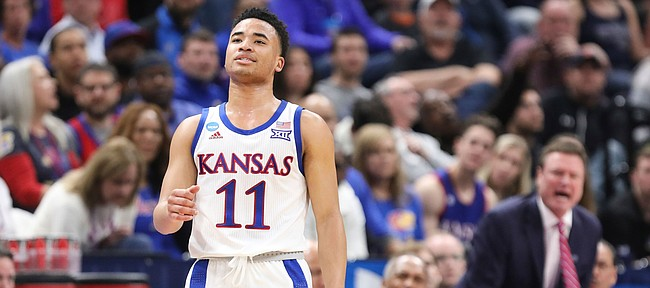 Kansas guard Devon Dotson (11) and the Kansas bench lament a missed steal during the first half on Saturday, March 23, 2019 at Vivint Smart Homes Arena in Salt Lake City, Utah.