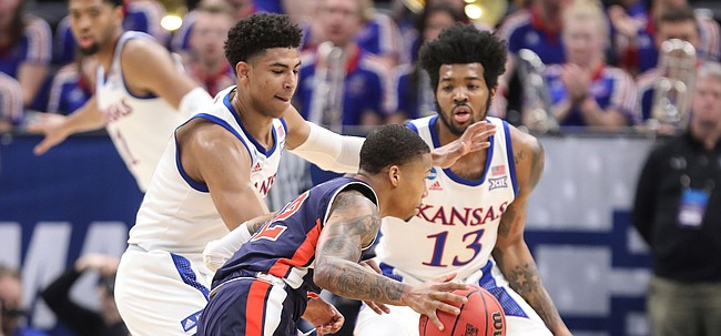 Kansas guard Quentin Grimes (5) and Kansas guard K.J. Lawson (13) defend against Auburn guard Will Macoy (22) during the first half on Saturday, March 23, 2019 at Vivint Smart Homes Arena in Salt Lake City, Utah.