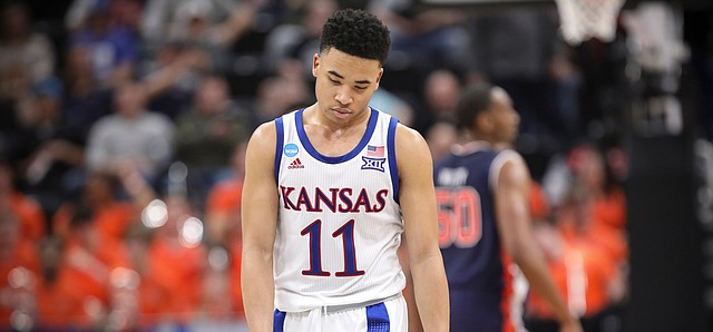 Kansas guard Devon Dotson (11) shows his frustration late in the second half against Auburn on Saturday, March 23, 2019 at Vivint Smart Homes Arena in Salt Lake City, Utah.