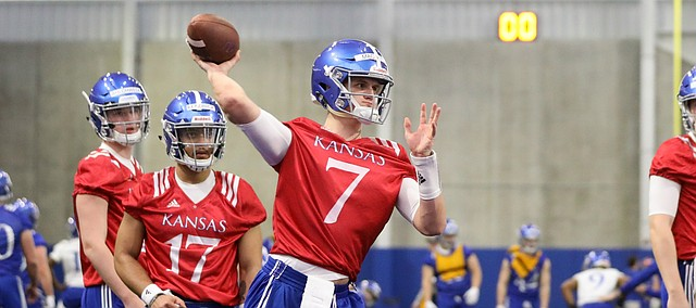 Kansas quarterback Thomas MacVittie throws during football practice on Wednesday, March 6, 2019 within the new indoor practice facility.