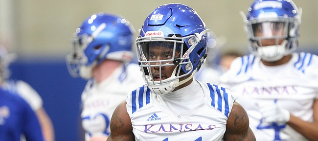 Kansas safety Mike Lee runs to another station for drills during football practice on Wednesday, March 6, 2019 within the new indoor practice facility.