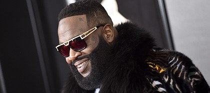 FILE — Rick Ross arrives at the 60th annual Grammy Awards at Madison Square Garden on Sunday, Jan. 28, 2018, in New York. The Grammy-nominated rapper will perform April 13 at the Kansas football team's spring game. (Photo by Evan Agostini/Invision/AP)