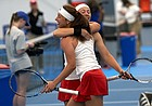 KU's Sonia Smagina and Anastasia Rychagova celebrates their team win during the Big 12 Championship Sunday afternoon at the Jayhawk Tennis Center on April 21, 2019.