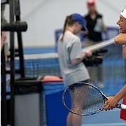 KU's Sonia Smagina and Anastasia Rychagova celebrates their team win during the Big 12 Championship Sunday afternoon at the Jayhawk Tennis Center on April 21, 2019.