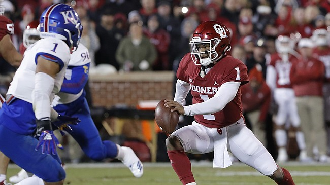 Oklahoma quarterback Kyler Murray (1) scrambles for a first down against Kansas during the first half of an NCAA college football game between Kansas and Oklahoma in Norman, Okla., Saturday, Nov. 17, 2018.