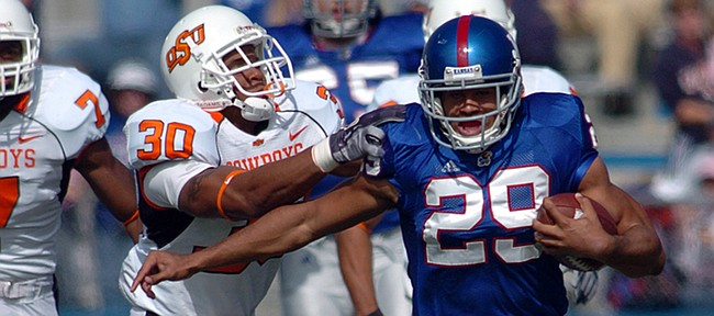 Former Kansas running back Jon Cornish tries to evade Oklahoma State defender Grant Jone in this Journal-World file photo from 2006.