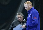 KU coach Todd Chapman looks over a lineup with an assistant coach in a match against Air Force Academy, at the Jayhawk Tennis Center,  February 24, 2019.