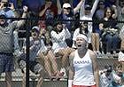 Kansas freshman Sonia Smagina and Kansas fans react to her win at No. 4 singles giving KU a 4-2 win against Florida Saturday afternoon at the Jayhawk Tennis Center. Kansas advances to the Sweet 16 next weekend.