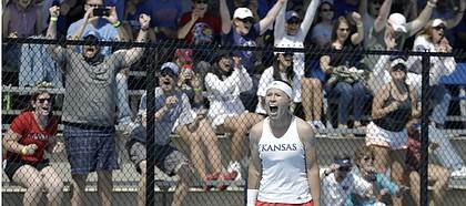 Kansas freshman Sonia Smagina and Kansas fans react to her win at No. 4 singles giving KU a 4-2 win against Florida on Saturday, May 4, 2019 at the Jayhawk Tennis Center. Kansas advances to the Sweet 16 next weekend.