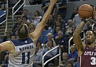 Little Rock guard Rayjon Tucker (3) shoots over Nevada's Cody Martin (11) during the first half of an NCAA college basketball game in Reno, Nev., Friday, Nov. 16, 2018.