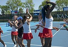 The Kansas tennis team celebrates a a 4-2 win against Florida on Saturday, May 4, 2019, at the Jayhawk Tennis Center. The win moved Kansas into the Sweet 16.