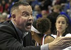 Kansas head coach Brandon Schneider talks to his team during the first half of an NCAA college basketball game against Baylor in Lawrence, Kan., Wednesday, Jan. 16, 2019. (AP Photo/Orlin Wagner)