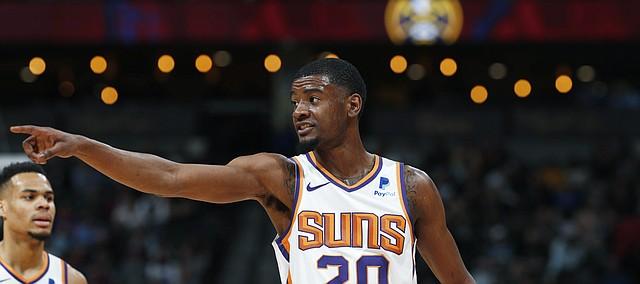 Phoenix Suns forward Josh Jackson (20) in the first half of an NBA basketball game Friday, Jan. 25, 2019, in Denver. (AP Photo/David Zalubowski)