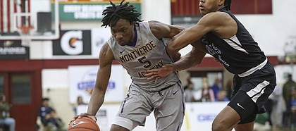 Montverde's Precious Achiuwa #5 in action against NSU University School in a Boys Quarterfinal game at the Geico High School Basketball Nationals in the Queens borough of New York on Thursday, April 4, 2019. (AP Photo/Gregory Payan)