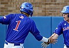 Kansas baseball players Benjamin Sems (1) and Casey Burnham celebrate a run during the Jayhawks' weekend sweep of in-state rival Kansas State at Hoglund Ballpark.