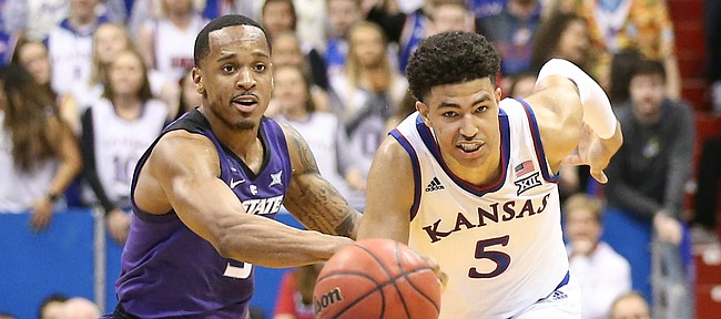 Kansas guard Quentin Grimes (5) and Kansas State guard Barry Brown Jr. (5) run down a loose ball during the second half, Monday, Feb. 25, 2019 at Allen Fieldhouse.