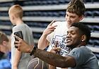 Kansas forward Silvio De Sousa shoots a selfie with camper Mikey Barton during a Washburn University basketball camp on Tuesday, June 4, 2019 at Lee Arena in Topeka.