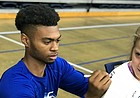 Kansas freshman guard Issac McBride signs autographs for campers on Thursday, June 6, 2019, at Brett Ballard's Washburn basketball camp, at Lee Arena, in Topeka.