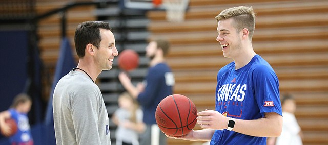 Kansas walk on Michael Jankovich, son of former KU assistant Tim Jankovich, who is the current head coach at SMU, laughs with Wasbhurn head basketball coach Brett Ballard during a Washburn University basketball camp on Tuesday, June 4, 2019 at Lee Arena in Topeka.