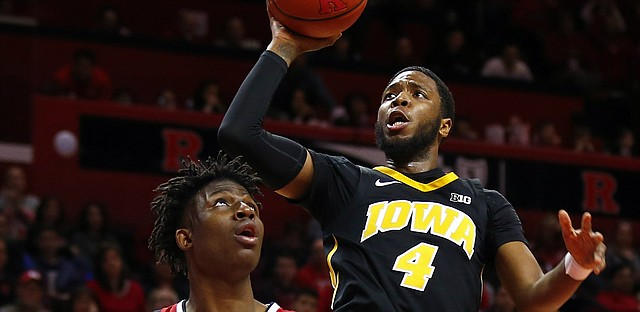 Iowa guard Isaiah Moss (4) shoots over Rutgers forward Shaq Carter (13) during the first half of an NCAA college basketball game Saturday, Feb. 16, 2019, in Piscataway, N.J.
