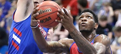 Kansas forward Silvio De Sousa gets to the bucket against Kansas forward Mitch Lightfoot during a scrimmage on Tuesday, June 11, 2019 at Allen Fieldhouse.