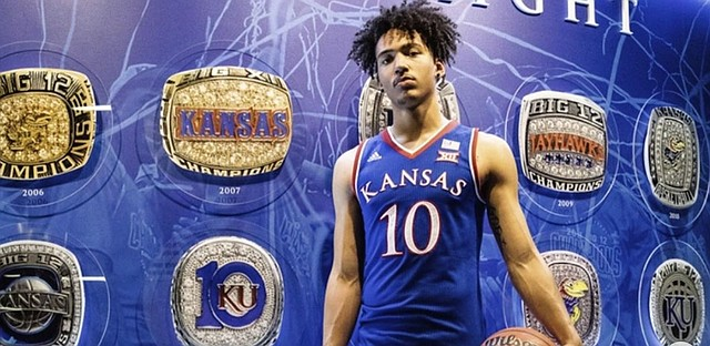 New Kansas commitment Jalen Wilson, a 6-foot-8, 210-pound wing forward from Denton, Texas, poses in KU gear during his visit to Lawrence in late May of 2019. Wilson picked the Jayhawks over North Carolina and Michigan on Wednesday, June 12, 2019.