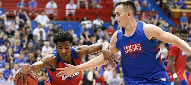 Kansas guard Ochai Agbaji (30) and Kansas forward Mitch Lightfoot (44) vie for a loose ball during a scrimmage on Tuesday, June 11, 2019 at Allen Fieldhouse.