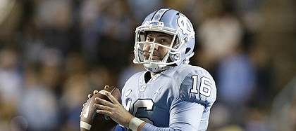 FILE — Quarterback Manny Miles (16) looks to pass against Western Carolina during the second half of for North Carolina, in Chapel Hill, N.C., Saturday, Nov. 17, 2018. The son of Kansas football coach Les Miles, Manny is joining the Jayhawks as a graduate transfer. (AP Photo/Gerry Broome)