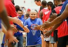 "Eleven-year-old Sergio Gomez, a member of the Rock Chalk Roundball Classic ""Starting Five"" greets the players before tipoff on Thursday, June 20, 2019 at Eudora High School."