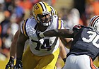 FILE — LSU offensive tackle Vadal Alexander (74) in action against Auburn linebacker Tre' Williams (30) in the second half of an NCAA college football game against Auburn in Baton Rouge, La., Saturday, Sept. 19, 2015. LSU won 45-21. (AP Photo/Gerald Herbert)