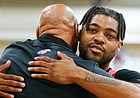 Red Team guard Frank Mason III hugs former coach Fred Quartlebaum during the Rock Chalk Roundball Classic on Thursday, June 20, 2019 at Eudora High School.
