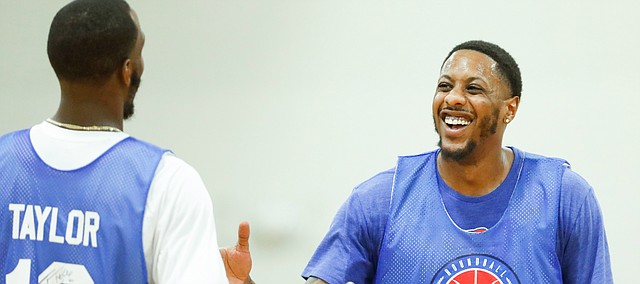 Blue Team guards Mario Chalmers and Tyshawn Taylor have a laugh during the Rock Chalk Roundball Classic on Thursday, June 20, 2019 at Eudora High School.