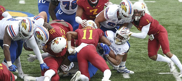 Kansas running back Khalil Herbert (10) is stopped under a pile of players late during the second quarter, Saturday, Nov. 3, 2018 at Memorial Stadium.