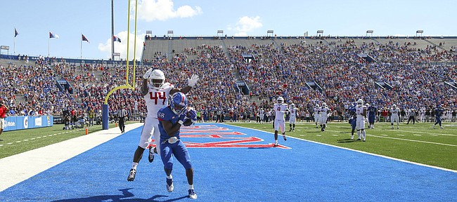 Kansas wide receiver Jeremiah Booker (88) catches a touchdown pass before Rutgers linebacker Tyreek Maddox-Williams (44) during the first quarter on Saturday, Sept. 15, 2018 at Memorial Stadium.