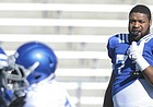 Kansas offensive lineman Cam Durley (71) watches a drill as two linemen go head to head during practice on Tuesday, April 11, 2016 at Memorial Stadium.