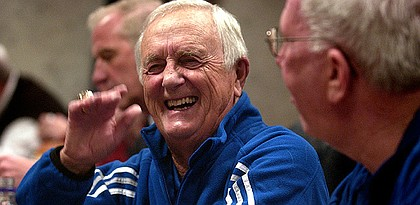 Kansas University announcer Max Falkenstien laughs during a conversation with radio cohort Bob Davis, right. Falkenstien, shown Jan. 4 in Allen Fieldhouse before KU's game against Yale, will broadcast his final game in the venerable building tonight.