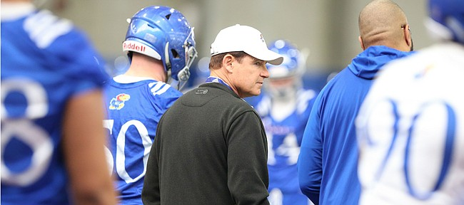 Kansas head coach Les Miles surveys his team during football practice on Wednesday, March 6, 2019 within the new indoor practice facility.