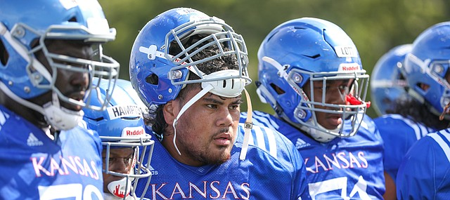 Kansas center Api Mane watches two teammates in the Jayhawk drill during practice on Friday, Aug. 9, 2019.